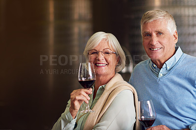 Buy stock photo Cropped portrait of an affectionate senior couple wine tasting in a cellar