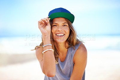 Buy stock photo Shot of an attractive young woman at the beach