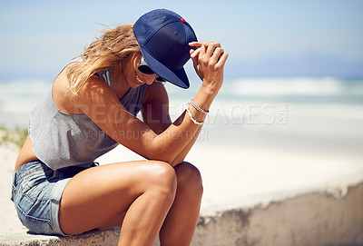 Buy stock photo Shot of a an attractive young woman at the beach
