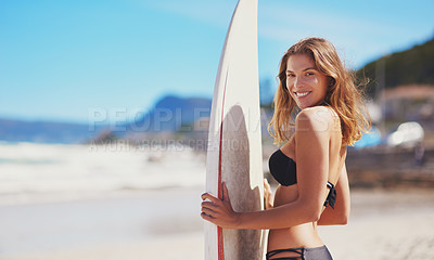 Buy stock photo Portrait of a young surfer standing on the beach
