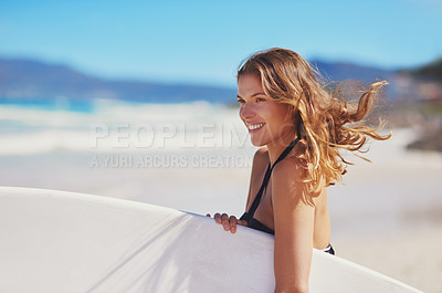 Buy stock photo Shot of a young surfer at the beach