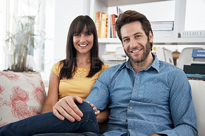 Buy stock photo Cropped shot of a couple relaxing at home