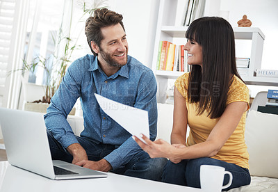 Buy stock photo Cropped shot of a couple using a laptop at home