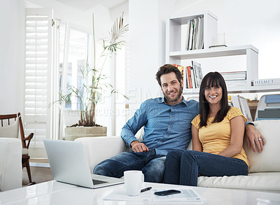 Buy stock photo Cropped portrait of a couple using a laptop at home