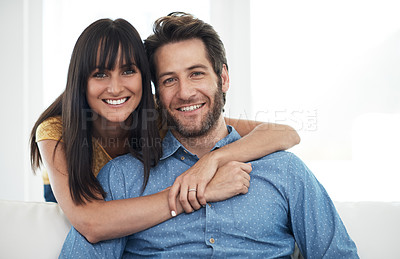 Buy stock photo Cropped portrait of a couple embracing at home