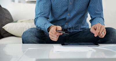 Buy stock photo Cropped shot of an unrecognizable man shopping online at home