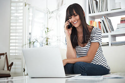 Buy stock photo Cropped shot of a woman browsing the internet at home