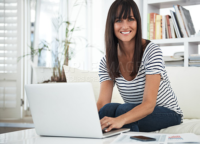 Buy stock photo Cropped portrait of a woman browsing the internet at home