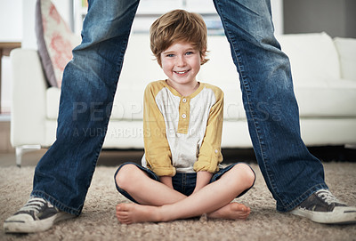 Buy stock photo Portrait of a young boy sitting inbetween his father's legs