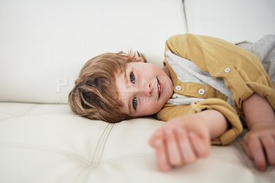 Buy stock photo Cropped shot of a little boy on the sofa at home