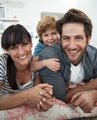 Buy stock photo Shot of a happy family of three at home