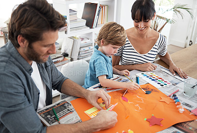 Buy stock photo Shot of parents helping their son with an art project