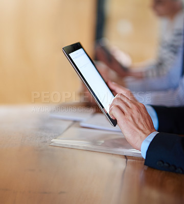 Buy stock photo Closeup shot of businesspeople using digital tablets during a conference