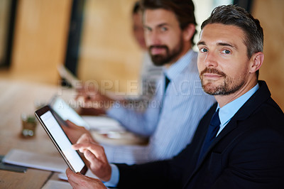 Buy stock photo Portrait of a businessman using a digital tablet during a conference