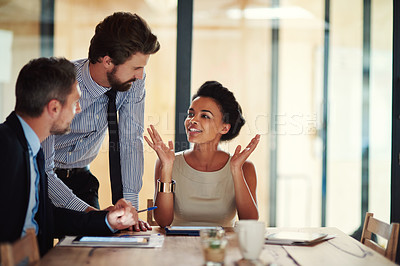 Buy stock photo Shot of a group of colleagues working together in an office
