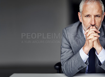 Buy stock photo Cropped portrait of a mature businessman looking pensive in his office