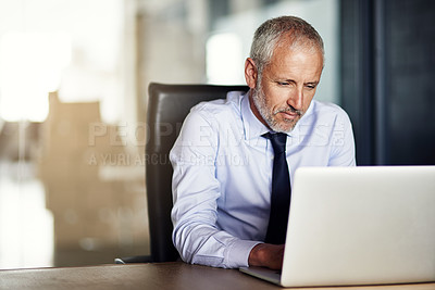 Buy stock photo Cropped shot of a mature businessman working in his office