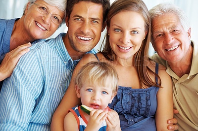 Buy stock photo Portrait of cute family smiling with little kid eating watermelon