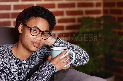 Buy stock photo Shot of a young woman having coffee while relaxing at home