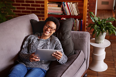 Buy stock photo Shot of a young woman relaxing at home on the weekend
