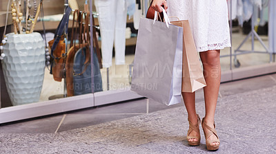 Buy stock photo Cropped shot of an unrecognizable woman shopping in a clothing store