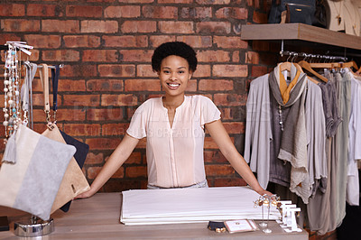 Buy stock photo Cropped portrait of a young woman standing in her clothing boutique