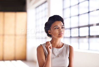 Buy stock photo Cropped shot of a  businesswoman looking thoughtful while standing in her office