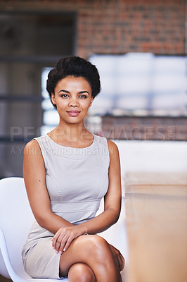 Buy stock photo Cropped shot of a young businesswoman sitting in her office