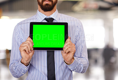 Buy stock photo Shot of a businessman holding up a digital tablet displaying chromakey