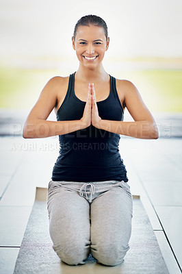 Buy stock photo Full length portrait of a young woman meditating