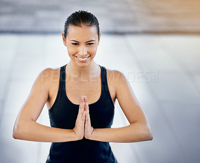 Buy stock photo Cropped shot of a young woman meditating