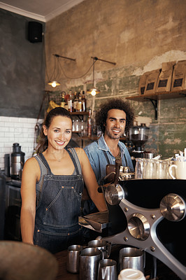 Buy stock photo Portrait of two young baristas working in a coffee shop