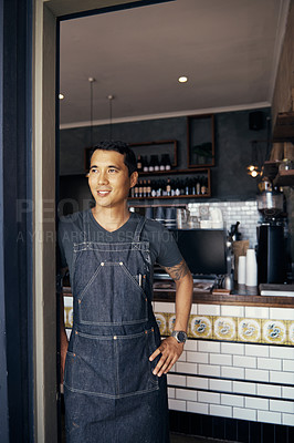 Buy stock photo Shot of a barista standing in the doorwayof a coffee shop