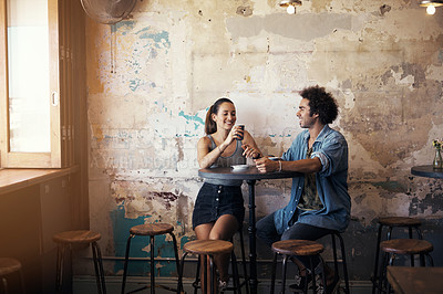 Buy stock photo Shot of a young couple having a coffee date at a cafe