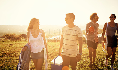 Buy stock photo Shot of a group of friends looking for a spot to have a picnic