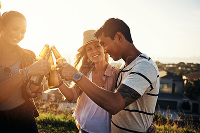 Buy stock photo Shot of a group of friends having drinks while out on a picnic