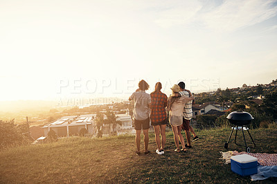Buy stock photo Rearview of four friends admiring the beauty of the cityscape