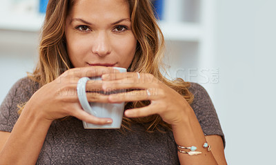 Buy stock photo Portrait of a young woman enjoying a warm beverage at home
