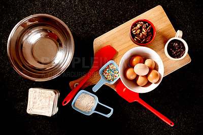 Buy stock photo High angle shot of a ingredients for baking a sweet dessert