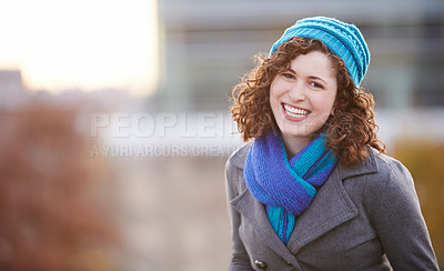 Buy stock photo Shot of a young woman out on a cold winter's day