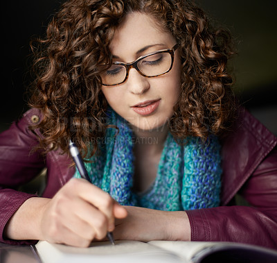 Buy stock photo Cropped shot of a woman writing in her journal
