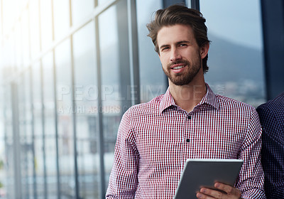 Buy stock photo Portrait of a young businessman using a digital tablet outside of an office building