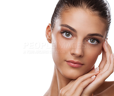 Buy stock photo Studio portrait of a beautiful young woman touching her face isolated on white