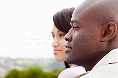Buy stock photo Shot of a smiling young couple enjoying a day outside together
