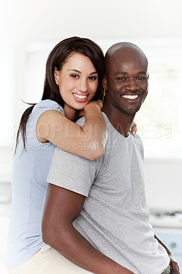 Buy stock photo Portrait of an affectionate young couple sitting in their bedroom