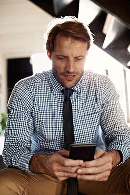 Buy stock photo Shot of a man reading a text message