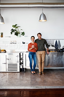 Buy stock photo Portrait of a smiling couple standing in their kitchen