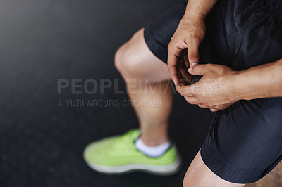 Buy stock photo Shot of a young athlete working out in the gym