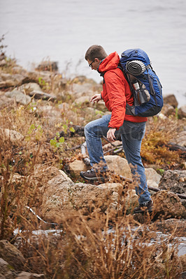 Buy stock photo Shot of a young man out hiking