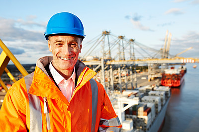 Buy stock photo Portrait of a mature man in workwear standing outside on a large commercial dock